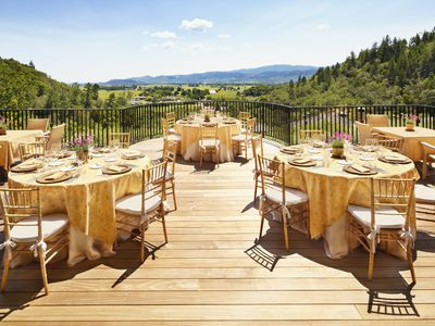 Patio overlooking hills and mountains set up for an upcoming event.