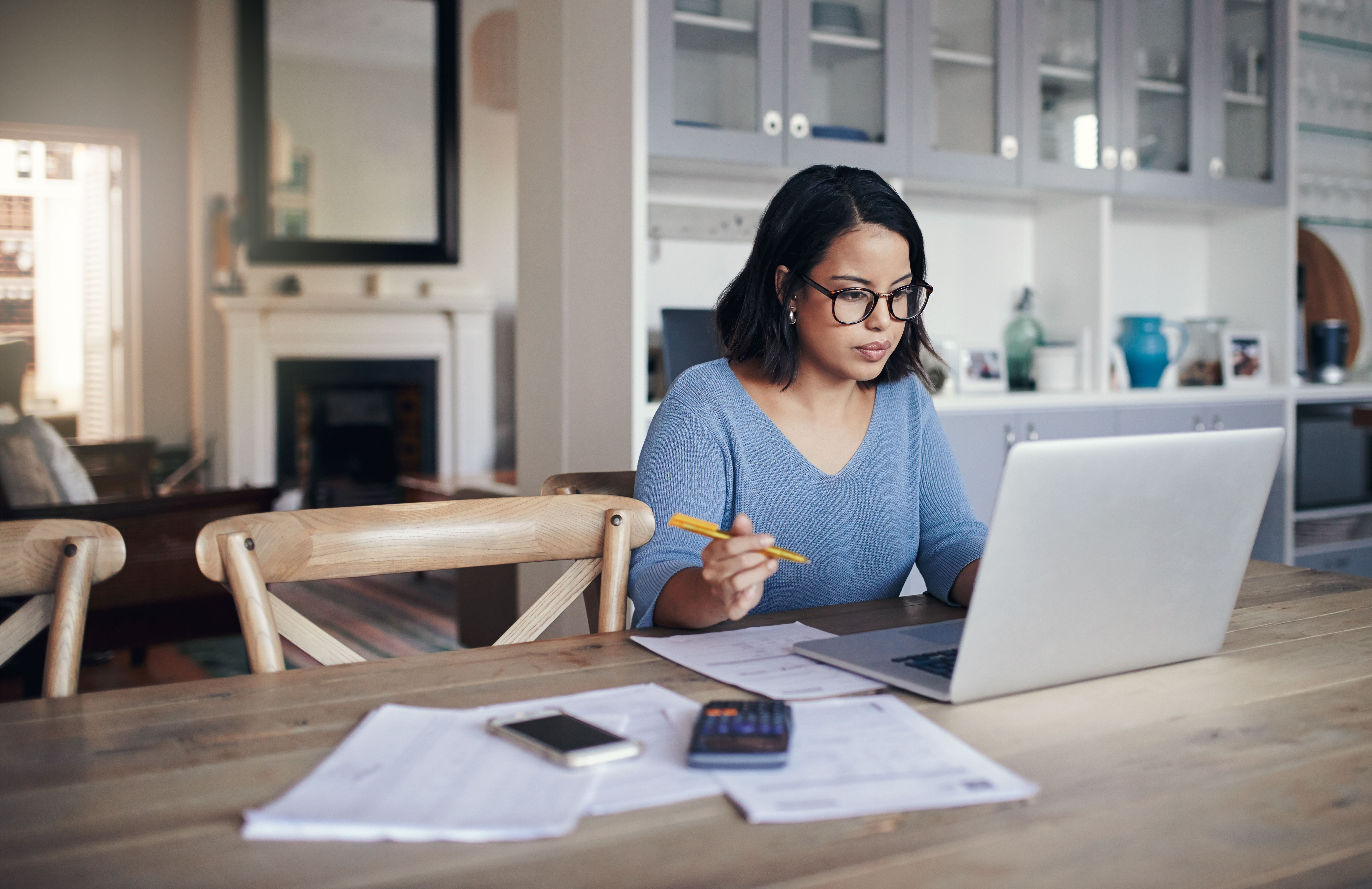 Woman using a laptop while working from home