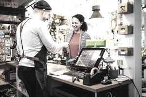Cashier rings up customer at a gardening store