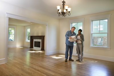 Man and woman looking at house plans during a property inspection