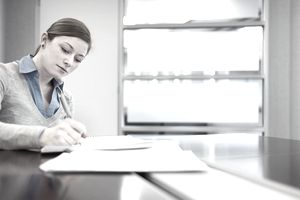A young woman taking notes