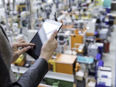 Distributor using tablet in factory