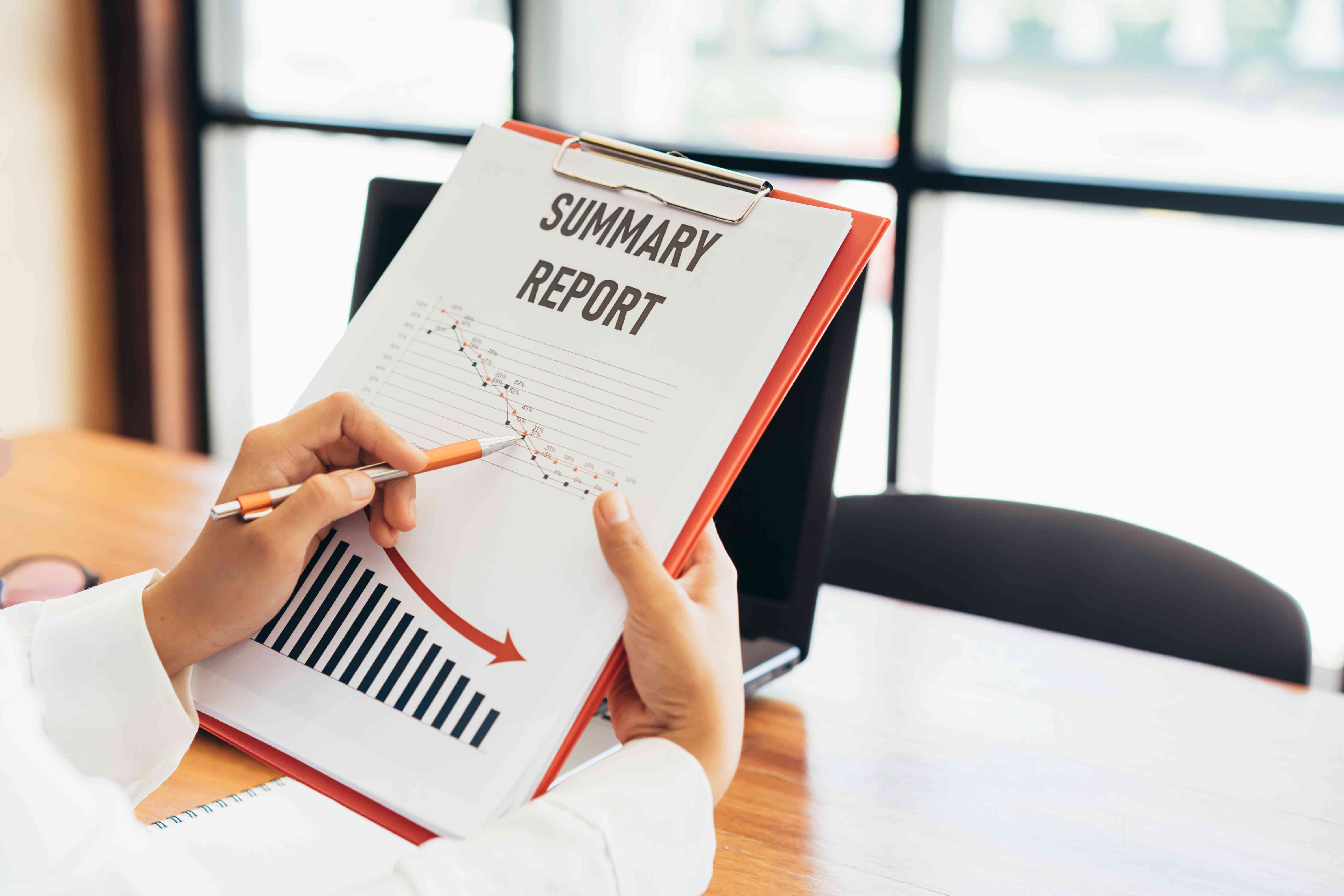 Business woman hands inspection about point of profit loss on business report.