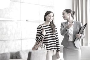 Real estate agent showing a woman a property