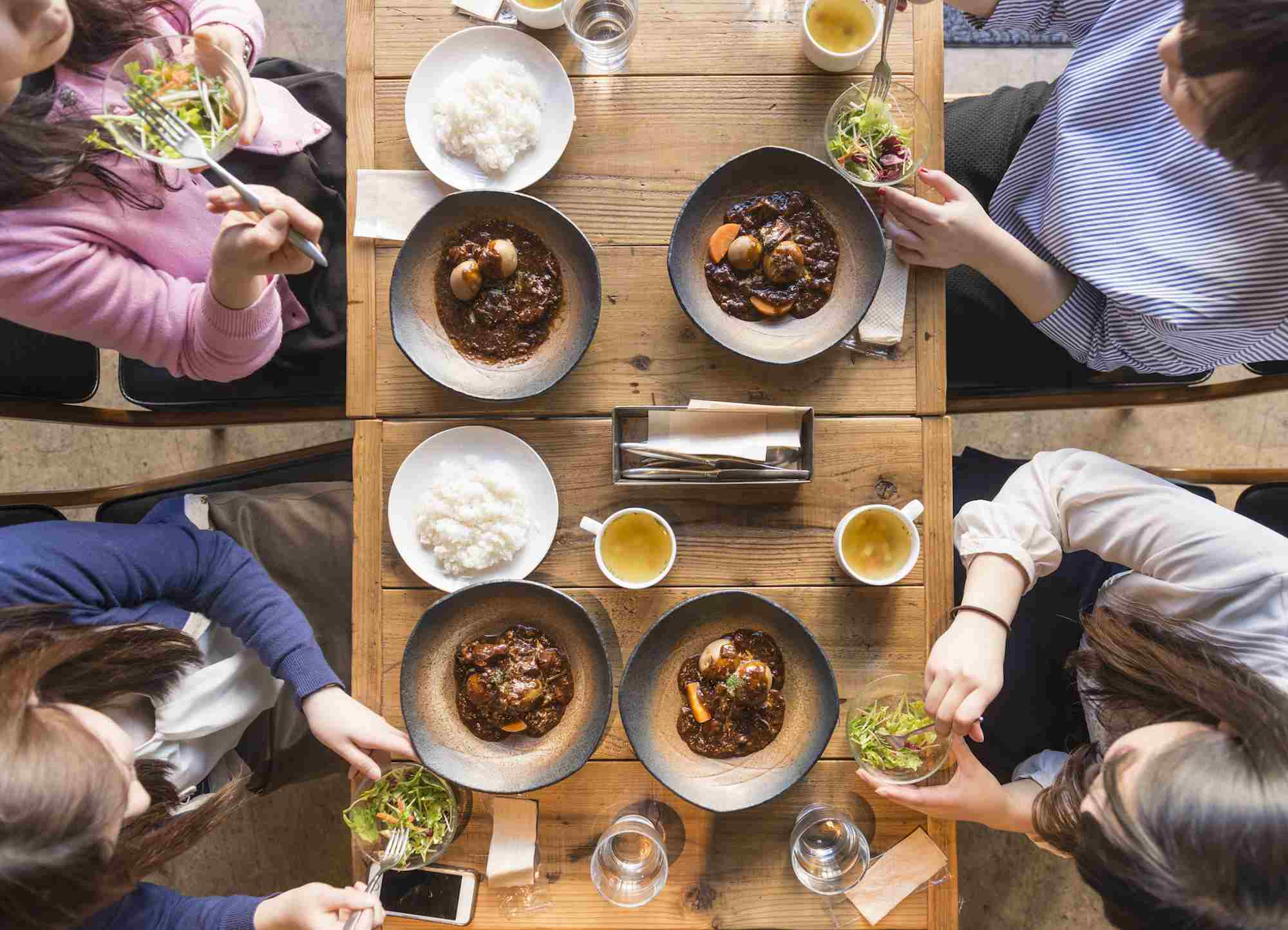 Elevated view of four women eating.