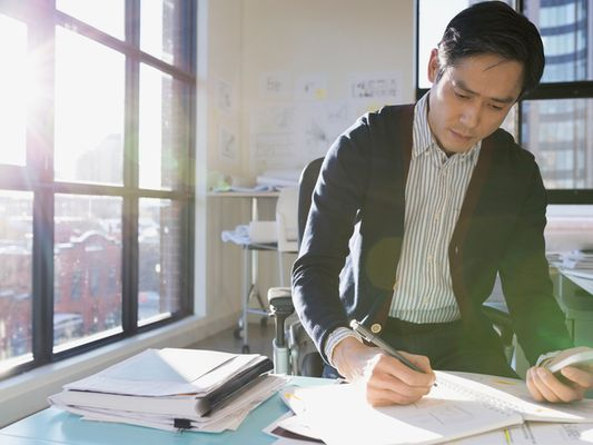 Man working on a business plan at a desk.