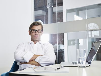 A business person sitting in front of a laptop