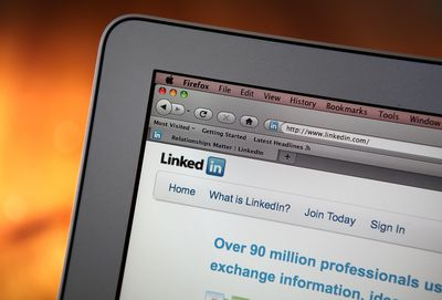 Close up of a laptop with the Linkedin homepage open.