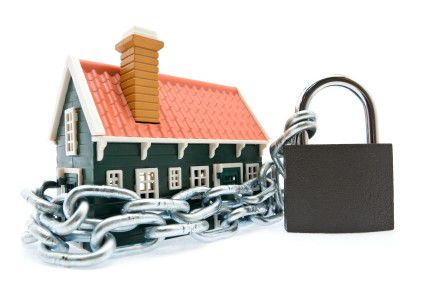 house surrounded by a chain and lock
