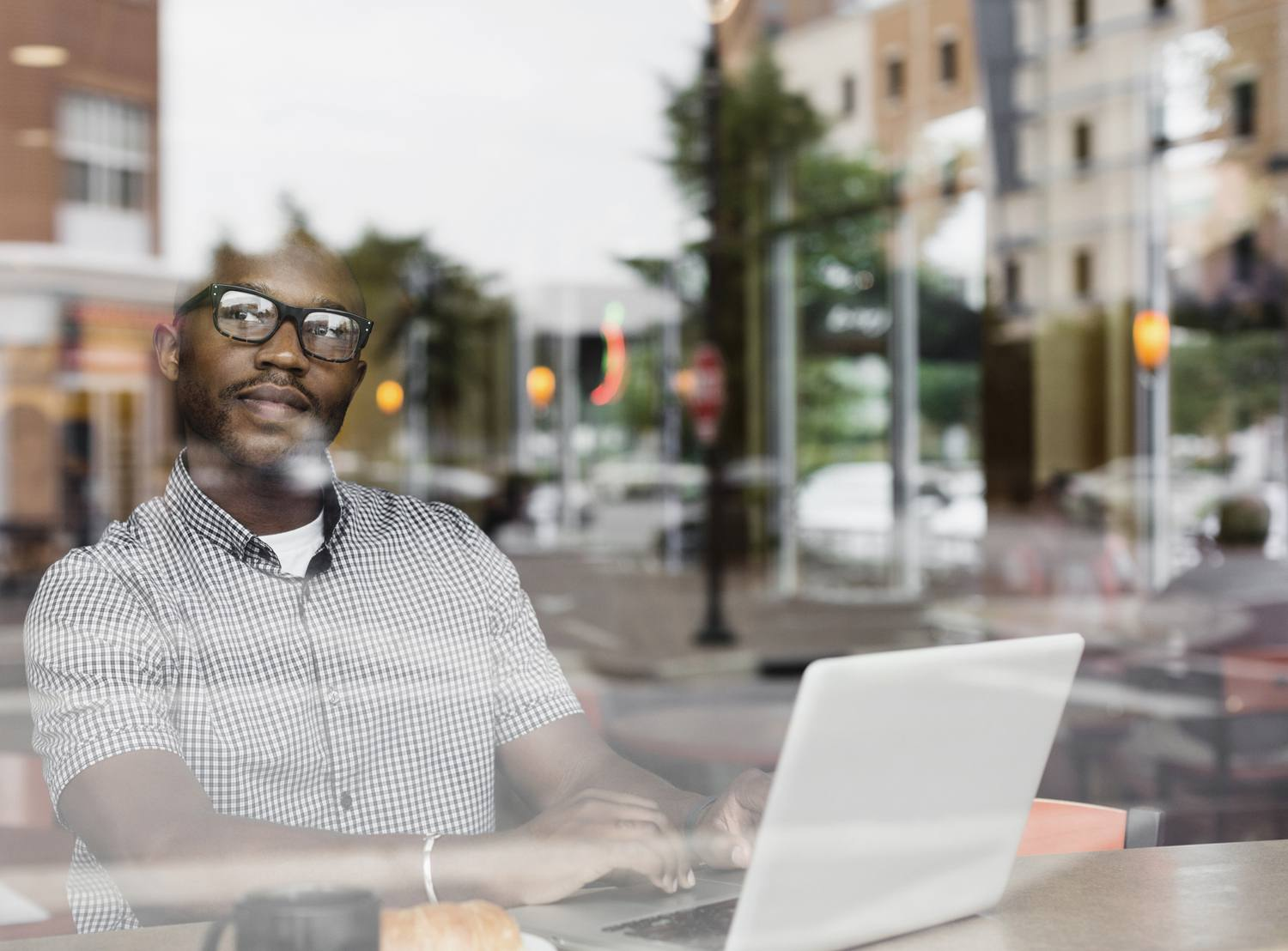 Business person working form remote location using laptop