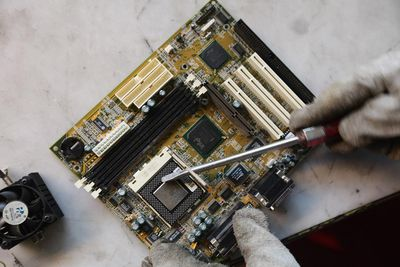 a person working on a computer motherboard
