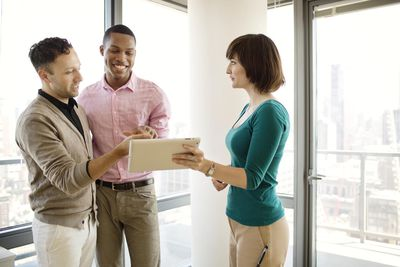 Discussing Plans with Real Estate Agent