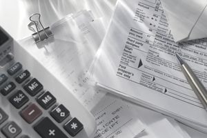 Tax forms, receipts, and a calculator for calculating taxes