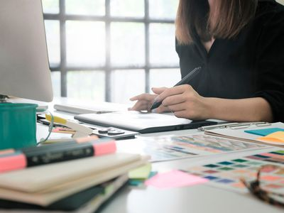 businesswoman working on business plan at a desk in an office