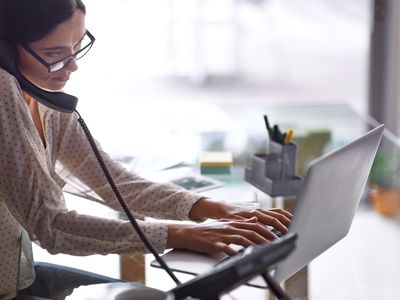 Receptionist answering and transferring phone call