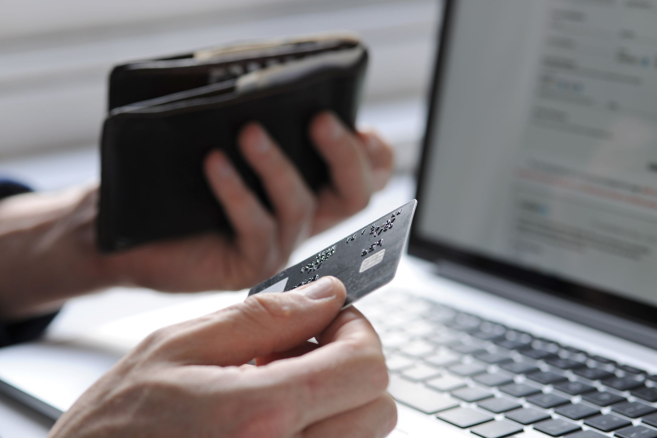 Person using a business credit card to purchase supplies.