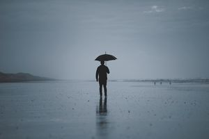 Man with umbrella.