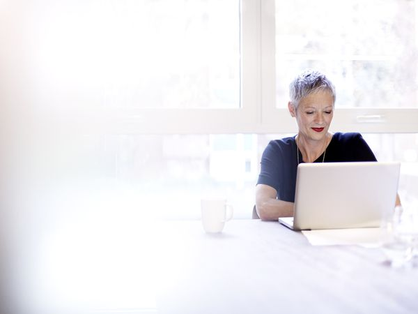 a businesswoman working on a laptop