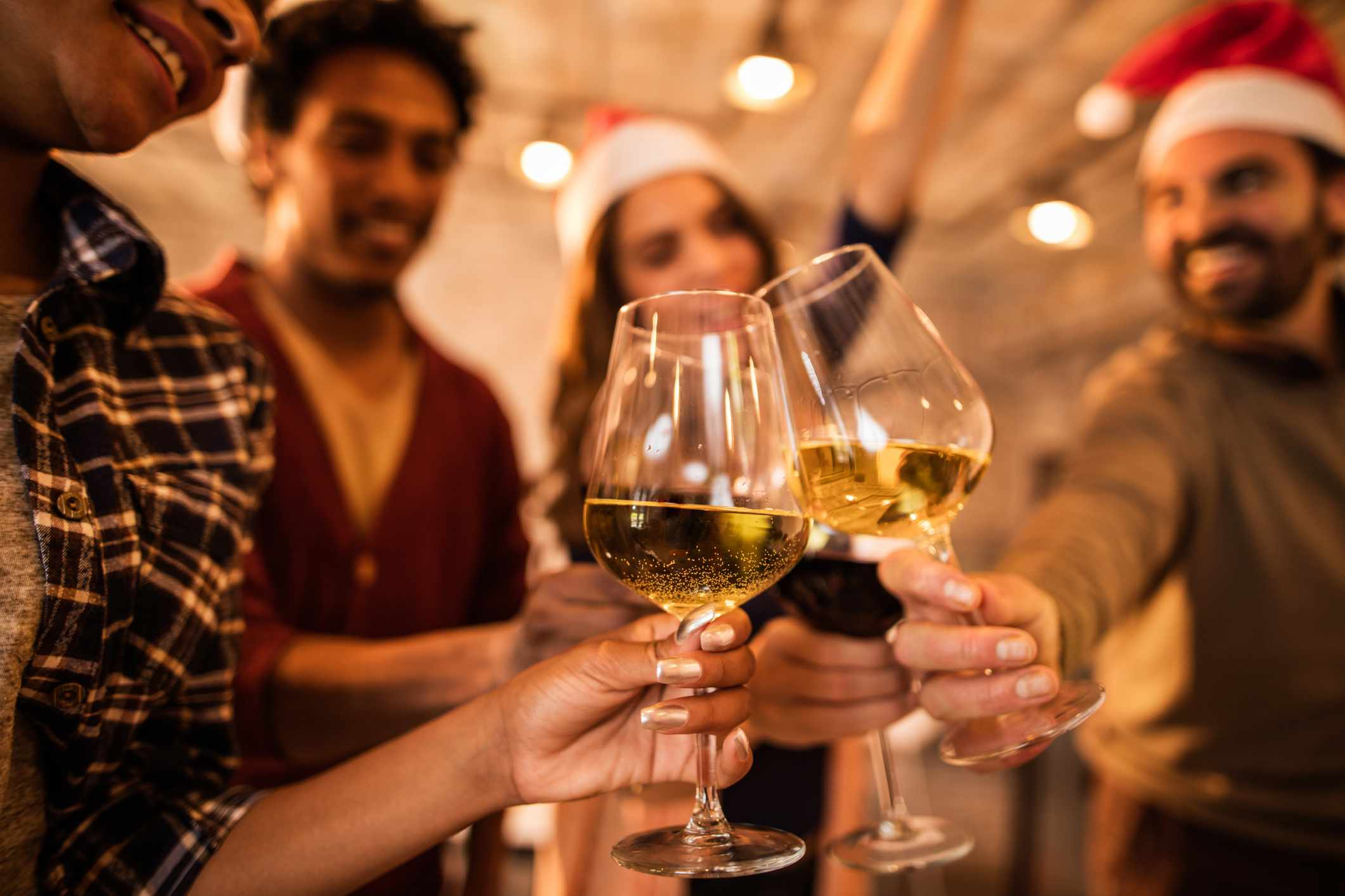 Staff toasting with wine at a holiday party