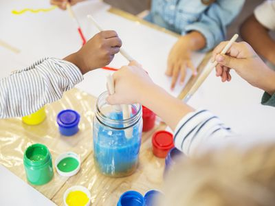 Kids painting in day care