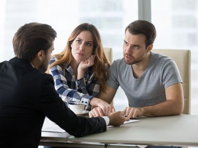 Angry couple arguing meeting lawyer having complaints on bad contract