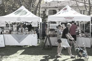 Stallholders and shoppers at the Elwood Farmers' Market in suburban Melbourne, Australia