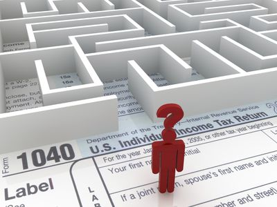 a figure standing at the entrance of a maze on top of a tax return