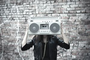 Woman Holding 80s Style Boombox