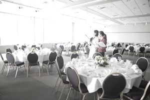 Businesswomen discussing place settings in luncheon room