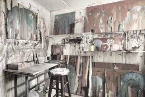 Paint splattered walls of art studio