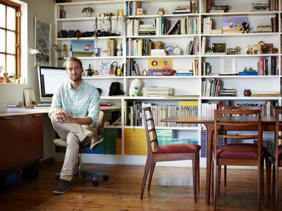 Man sitting at a desk in his home office