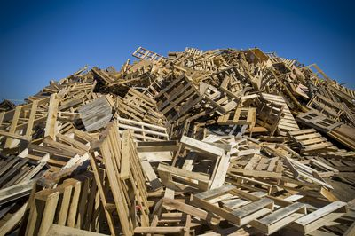 Large mound of used pallets in a dump