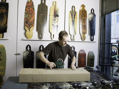 Man packaging up skateboards fro shipping