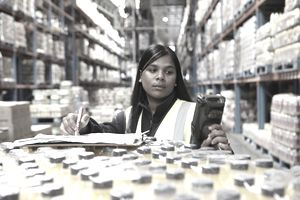 Worker taking inventory in a food distribution warehouse