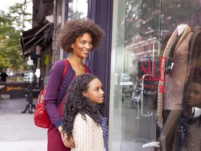 Mother and Daughter Window Shopping