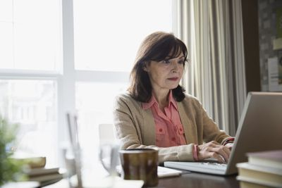 Woman installing ERP system on office computer
