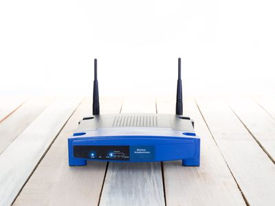 Wireless Router On Table Against White Background
