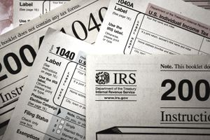 close up of multiple IRS documents piled on top of each other