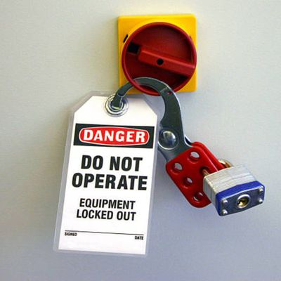 Lock our with tag secured to a disconnected electrical device.