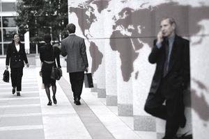 A group of business people by a map wall