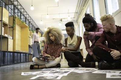 Group of designers reviewing a magazine galley