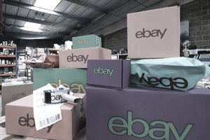Large collection of eBay packages prepared for shipping at an eBay seller's warehouse who utilized Cassini search engine