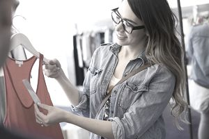 Woman buying clothing priced using keystone pricing method