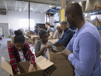 Father and daughters volunteering at a nonprofit organization