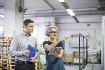 Man and woman conducting quality assurance