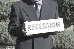Man holding a recession sign