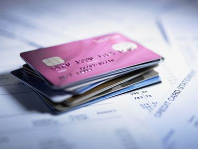 Stack of credit cards and statements