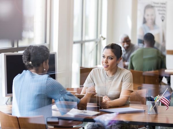 Woman discussing a business loan with a bank lender.