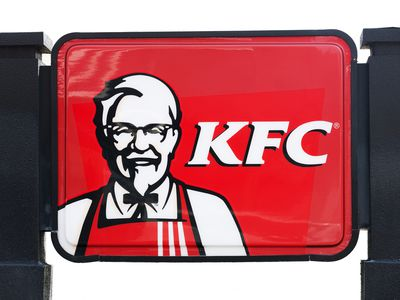 Kentucky Fried Chicken sign featuring an image of Colonel Sanders.