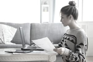 Young woman working with laptop in living room